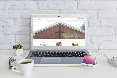 New Life Community Wesleyan Church website design mockup by The Marketing Machine Co. Jackson MI